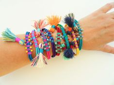 Adjustable wrap bracelet braided with shiny silk cord, macramé cord, tassels , eye charms, coins and more. Available in three styles to choose: 1 ) Only with crystal beads ( as photo No 2) 2) With crystal beads, eye and coin ( as photo No 5) 3) With crystal beads tassel and eye