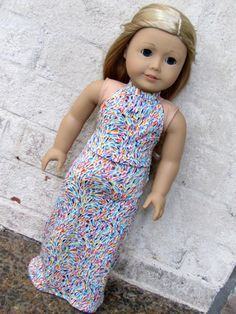 Your doll will be the coolest girl at the garden party with this fabulous multicolored maxi dress! Made with a super soft jersey knit from the world famous Liberty of London, the colors include hot pi