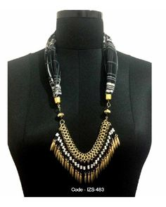 The time tested combination of black and white is back in this amazing stole complemented by the beautiful-heavy neckpiece which can make you the perfect diva at the parties.