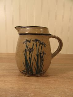 Salt glazed stoneware pitcher (signed) with iris floral design by HeathersCollectibles on Etsy