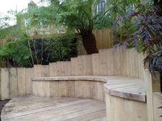 Chunky oak curved garden bench built by Garden Club London: