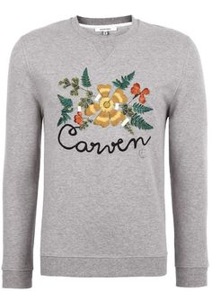 CARVEN: TENTASTIC, GREY MELANGE BOTANICAL EMBROIDERED SWEATSHIRT As seen on the 10 blog during Paris fashion week, sported by a rather glitzy Jason Lloyds Evans.Now book a flight to the alpine havens of Austria and let loose!  www.liberty.co.uk  by Matteo Sarti