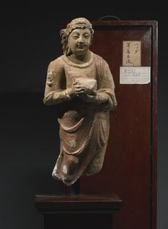 A GANDHARAN POLYCHROMED STUCCO FIGURE OF A DONOR 4TH / 5TH CENTURY