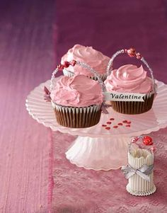 Dress up chocolate cupcakes for Valentine's Day by adding glittery garnishes. #desserts