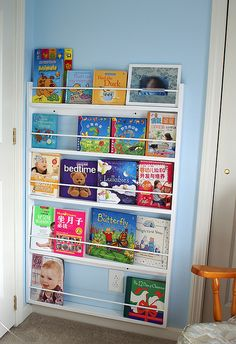 kind of looks like a shop shelf but such a good space saving idea!! Shallow book shelf sits behind the door... perfect idea!