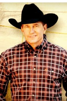 George Strait He could eat crackers in my bed anytime!!