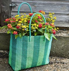 Great idea for reusing and redisplaying old bags - be sure to add a lining before filling with soil :)