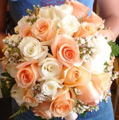 Beautiful corals, blush and white bridal bouquet by Mainstreet Flower Market.