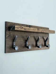 This Rustic Coat Rack measures x x Comes with 4 Double RR Spikes to hang your hats and coats on. Its built using solid pine wood. With a variety of Stain choices available. Has two predrilled holes with screws and sheet rock anchors for hanging. Railroad Spikes Crafts, Railroad Spike Art, Industrial Coat Rack, Rustic Coat Rack, Vintage Industrial, Metal Furniture, Rustic Furniture, Diy Furniture, Furniture Vintage