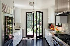 Galley kitchen with French doors to the outside