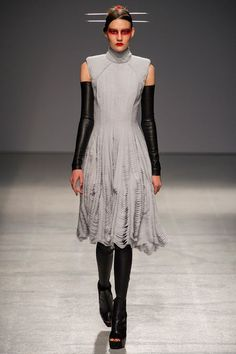 Gareth Pugh #23--My favorite look in his collection. That beautiful drapery looks incredible on delicate grey fabric and the leather sleeves and legs are very punk