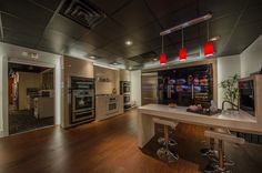 Tv showroom. Samsung. Miele. Double wall ovens. Stainless steel.