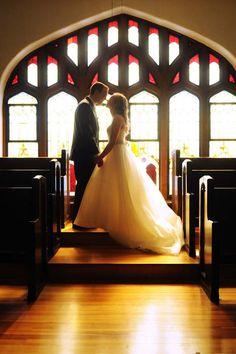 Bride and Groom at the altar. [Colorado Wedding Photography]