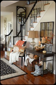 colors on stairs - black (or very dark stain), white, and wood -- notice trim along slant.