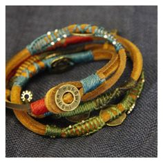 Fantastic leather bracelet wrapped with cotton fiber and flexible, embellished with copper charms- Can be worn as necklace or wrapped around wrist multiple times and worn as bracelet.