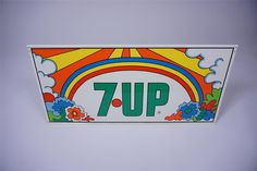 Sold* at Las Vegas 2016 - Lot #6151 NOS 1960s 7-up Soda double-sided tin sign with Peter Max graphics.