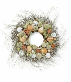 "Seacoast Wreath, Indoor/Outdoor by L.L.Bean. $59.00. Beautiful as an accent on your front door, wall or mantel this imaginatively designed wreath brings a touch of the beach to your home year-round. Natural shells, starfish, sea urchins and sand dollars are intertwined with natural grass and green paper hydrangea on a handmade twig base. An L.L.Bean exclusive design. Use indoors or in a sheltered outdoor location. 23"" diam. Imported."