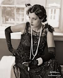 lots of pearls and the use of gloves to complete outfits. The garments were heavy with the detail of beading