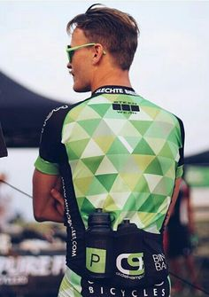 Pattern cycling jersey. Elasticated material and elasticated pockets at the back of the jersey for storage for the cyclists.