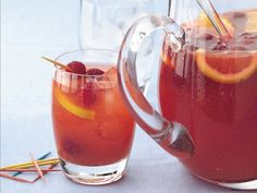 Raspberry-Apricot Sangria -Relax with a glass of this raspberry apricot-sangria, with fresh fruits and white wine. Lemon-lime flavored carbonation make it extra light and refreshing.