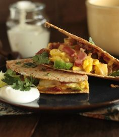 On the go? Whip up some of these portable and totally delicious Breakfast Quesadillas.