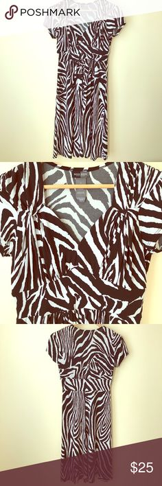 BISOU BISOU woman's dress A zebra patterned dress with a sweetheart neckline. Looks like new. Fabric is 96% polyester and 4% spandex.                                                           DISCOUNTED SHIPPING! Limited time. Bisou Bisou Dresses Midi