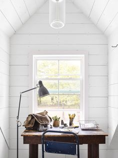 The petite desk, a treasured heirloom from Josh's side of the family, provides workspace in the master bedroom.