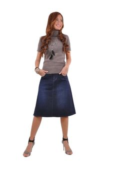"""Skirt details: * knee length 24"""" * regular fit * four pockets A-line style skirt * stretch mid-weight navy blue denim * front zipper & belt loops * 98% cotton, 2% spandex * Sweet and simple, this piec"""