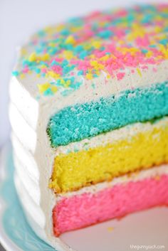 Layer on the colors of spring with this easy tri-colored cake for your spring holiday celebration. This fun dessert has thick, creamy icing and the most delicious sprinkled topping!
