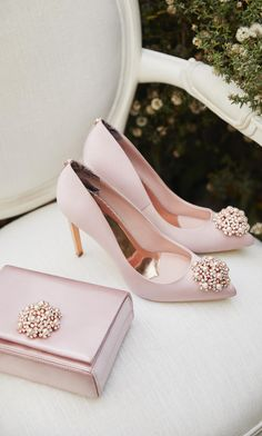 TIE THE KNOT: Put your best foot forward with Ted's delicate DAHRLIN courts. Elevating your bridal look to the next level, these satin shoes come with pointed toes embellished with pretty pearls and crystals Source by juliewilhite women shoes Cute Shoes, Me Too Shoes, High Heels, Shoes Heels, Shoes Pic, Prom Shoes, Stilettos, Satin Shoes, Wedding Dress Trends