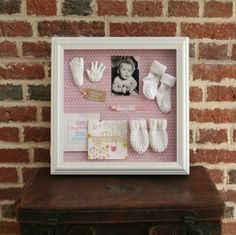Creating a baby memory box is an important way to remember those first baby moments. Use these ideas to save the most precious baby memories forever! Newborn Shadow Box, Baby Frame, Baby Memory Frame, Baby Box Frame Ideas, Shadow Box Frames, Baby Shadow Boxes, Baby Memories, Baby Keepsake, Baby Crafts