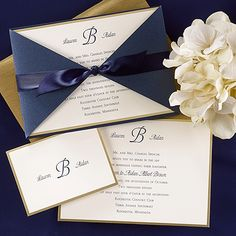 Blue Borders of Gold - Invitation from Carlson Craft - Item Number: BSN7049 - We've combined an ecru card with gold foil border with a shimmer navy wrap and tie it all together with a navy satin ribbon to make a beautiful wedding invitation that will make a statement.