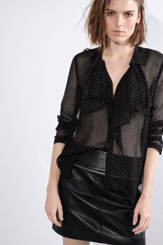 Zadig & Voltaire crêpe collarless blouse, sheer with gold polka dots, ruffled yoke, etched mother-of-pearl buttons, 100% viscose. Model is 181cm/ 5'9