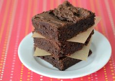 Rich, fudgey Paleo Brownies made with 100% dark chocolate and coconut oil, and lightly sweetened with dates and stevia are the perfect post-workout dessert.