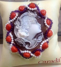 Shell Cameo with red/white coral and Amethist.