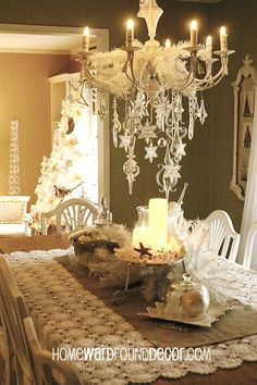 glass ornaments dress up a chandelier see more of my vintage white christmas