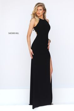 Smooth slim line elegance emanates from the Sherri Hill 32340 full-length prom dress. This jersey jersey gown showcases a high halter neckline and inset waistband. The tapered back bodice reveals a cutout midriff above the back waistline. The long skirt features a mid-thigh side slit and cleaves sensually to the figure as it flows into a gorgeous sweep train.