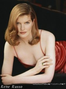 More of Rene Russo, looking like a 1940s bombshell with the Veronica Lake-esque hair and the red dress!