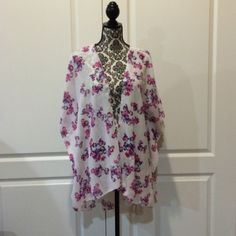 Charlotte Russe floral print kimono Charlotte Russe Kimono is white with pink flowers. Very cute with jeans. Charlotte Russe Tops