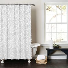 Bring an elegant, stylish update to your bathroom with the Lush Décor Keila Fabric Shower Curtain. Featuring a calm circular motif, this softly-hued curtain is beautifully crafted with ruched embroidery for the perfect touch of dimensional texture.