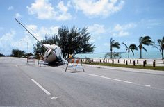 1992 - Hurricane Andrew Dates active: August 16 - 28 Peak classification: Category 5 Sustained wind speed: 175 mph (280 km/h) Areas affected: Bahamas, Florida, United States Gulf Coast Deaths: 65 Damage: $26.5 billion (Pictured) A yacht beached on the road after Hurricane Andrew hit Miami, Florida.