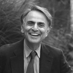 Carl Sagan I find this wonderful man's smile so beautiful.  When I watch/hear him speak, with such eloquence, I can sense his love for the cosmos, and in turn makes me share in the enthusiasm and love for it.  I wish I could have met this wonderful man in my lifetime.