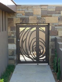 Nice Gate/ idea for wrought iron or stained glass. Reminiscent of Rennie Macintosh (modern exterior by Suzman Design Associates)
