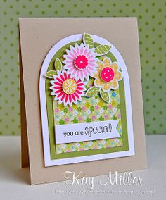 All of the flowers and leaves are from Papertrey Ink, the sentiment is from Clearly Besotted, and the arched dies are from Sizzix...