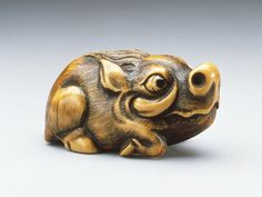 Japan  Wild Boar, 18th century  Netsuke, Ivory with staining, sumi, inlays. LACMA