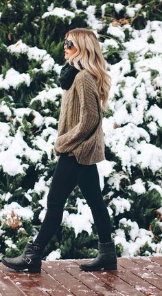 This is a great winter outfit. I absolutely adore her boots and her knit sweater. Her outfit looks super comfy and chic.