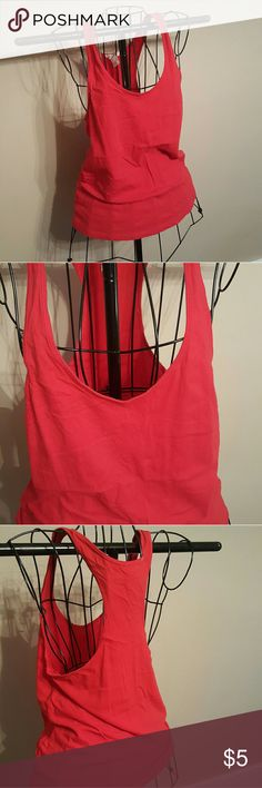 Forever 21 loose fitting scoop neck racer back This red basic is great for layering or showing off a cute bralette. The neck and arm holes are very low cut so anything underneath is definitely seen. The fit is very relaxed and comfortable. Tag says small, but easily fits a medium as well. Some minor signs of washing but no rips/holes/stains etc. Will accept lower price if bundled. Forever 21 Tops Tank Tops