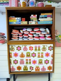 My up-cycled 70s unit covered in 70s vintage wallpaper