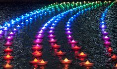 Voyage: A Fleet of 300 Illuminated Boats in Canary Wharf by Aether & Hemera. Photo by Sean Batten.