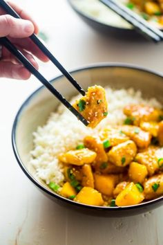 This mango chicken is served over coconut cauliflower rice for a quick, easy and healthy spin on take-out! It's whole 30 approved and paleo friendly too!